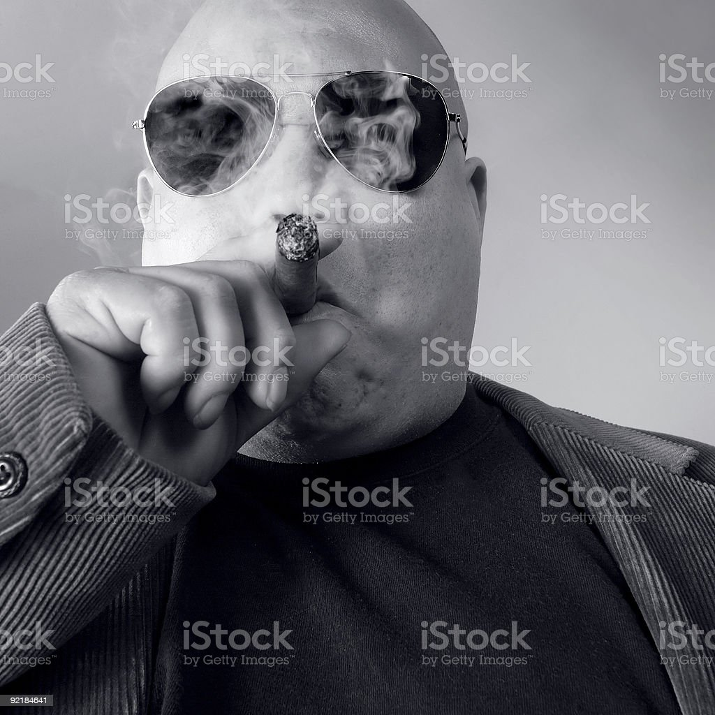 Big tough boss wearing sunglasses and smoking a cigar stock photo