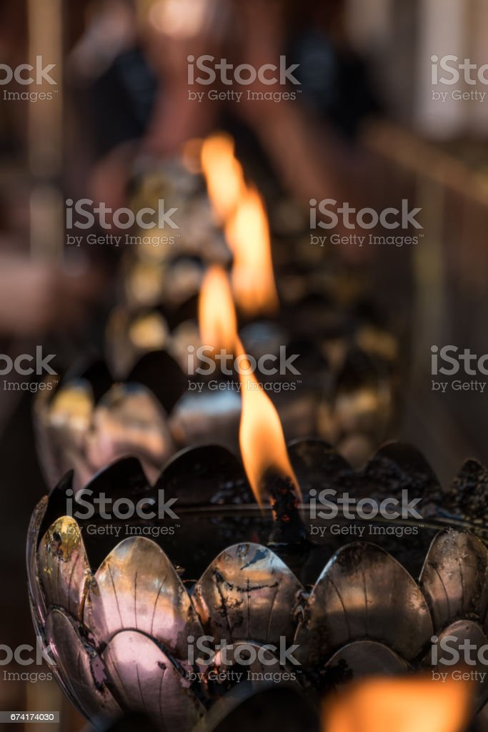 Big traditional candles in buddhist temple Thailand stock photo