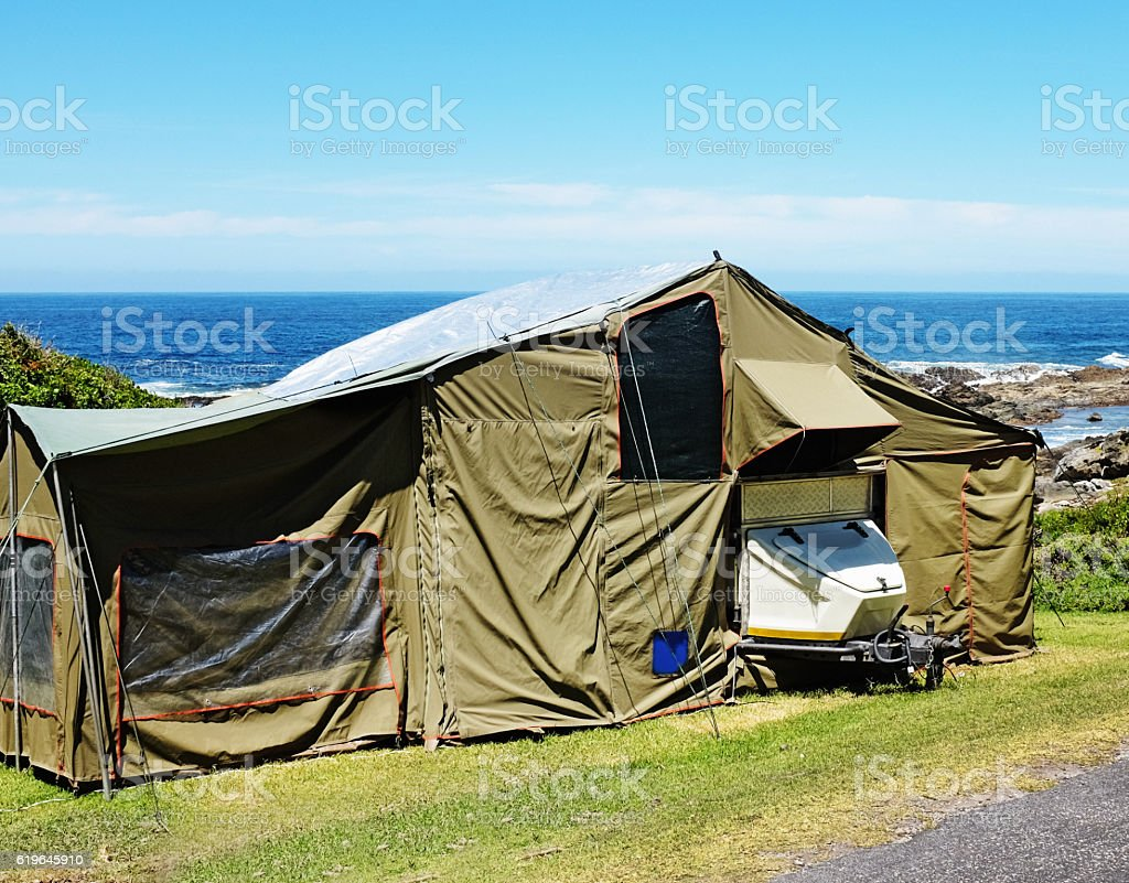 Big trailer tent  at seaside camp site stock photo