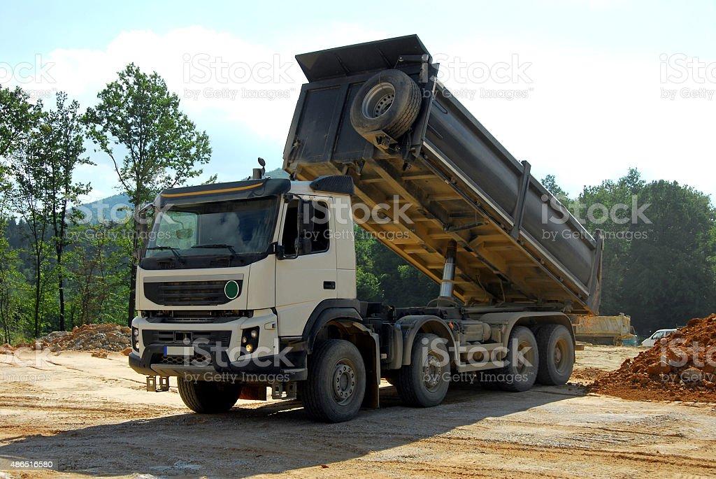 big truck tipper at work stock photo