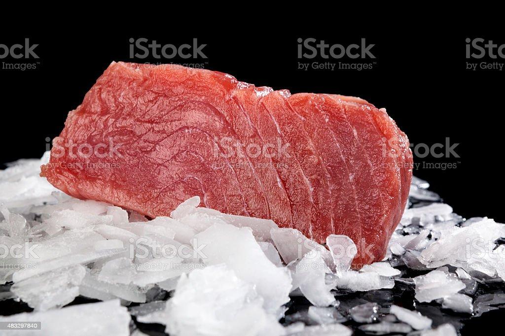 Big tuna steak on ice. stock photo