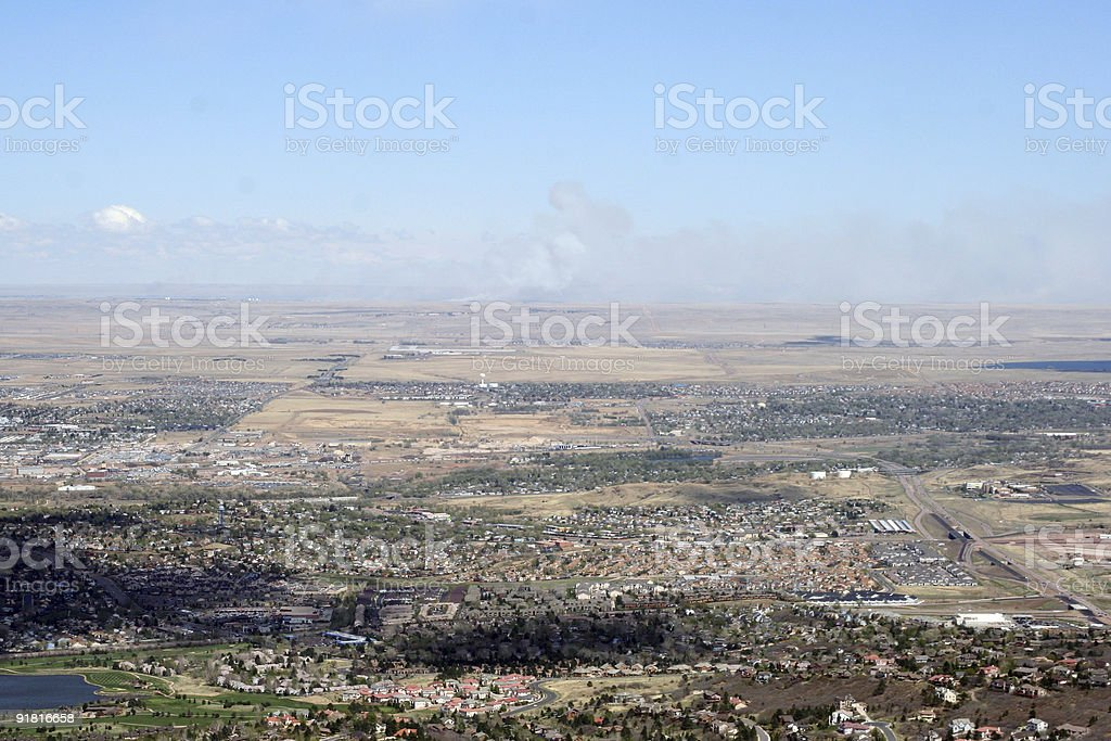 Big view over Colorado Springs and fire on the horizon royalty-free stock photo