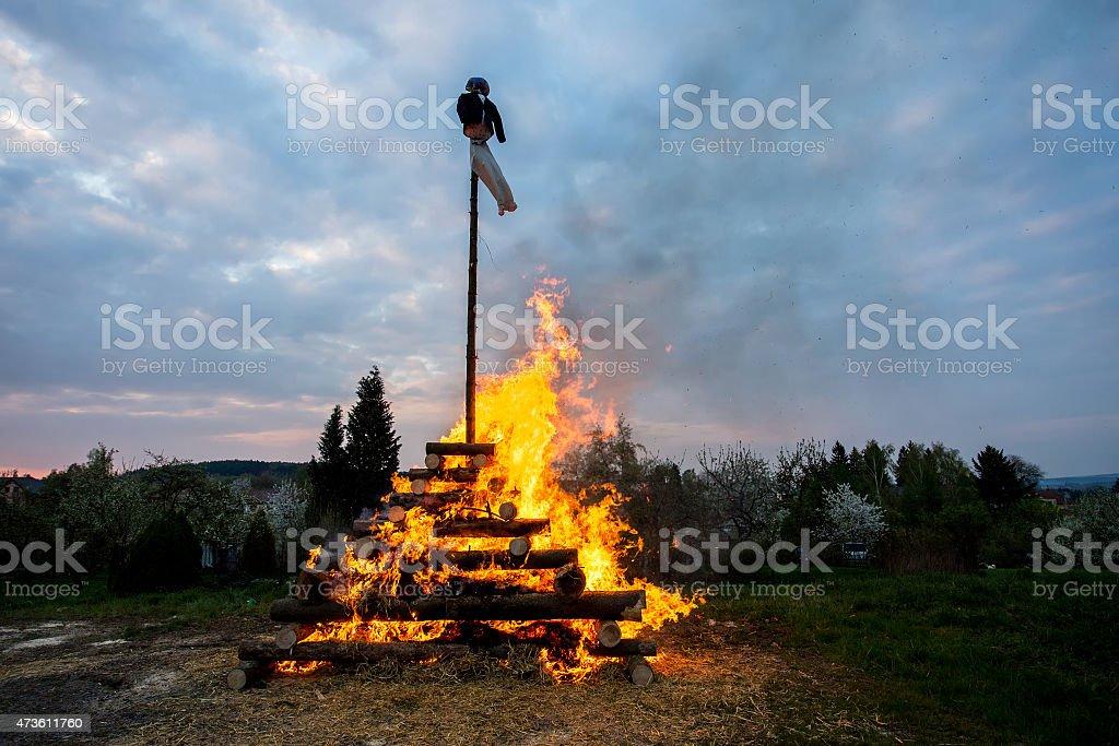 big walpurgis night fire with witch stock photo
