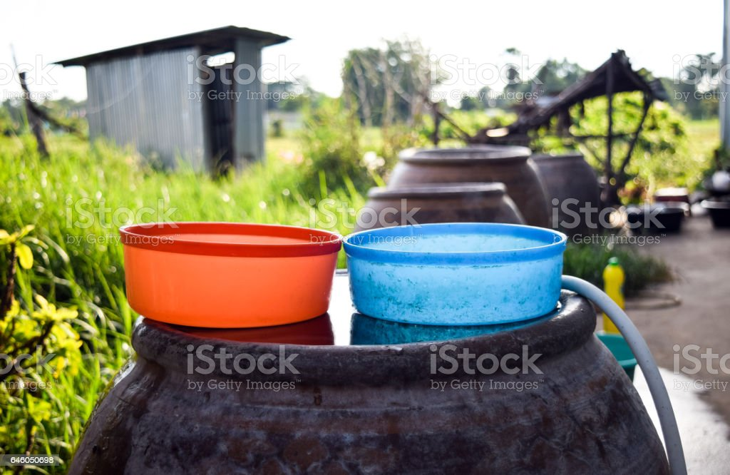 big water jar with color water bowl stock photo