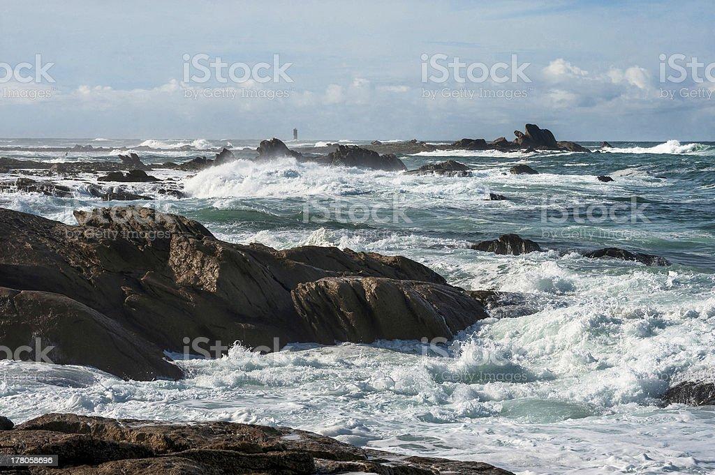 Big waves broken near stone seashore of France royalty-free stock photo