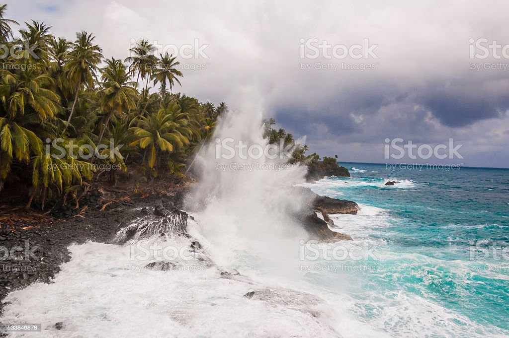 Big waves crushing on the shore of a tropical island stock photo