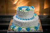 big wedding cake with blue flowers
