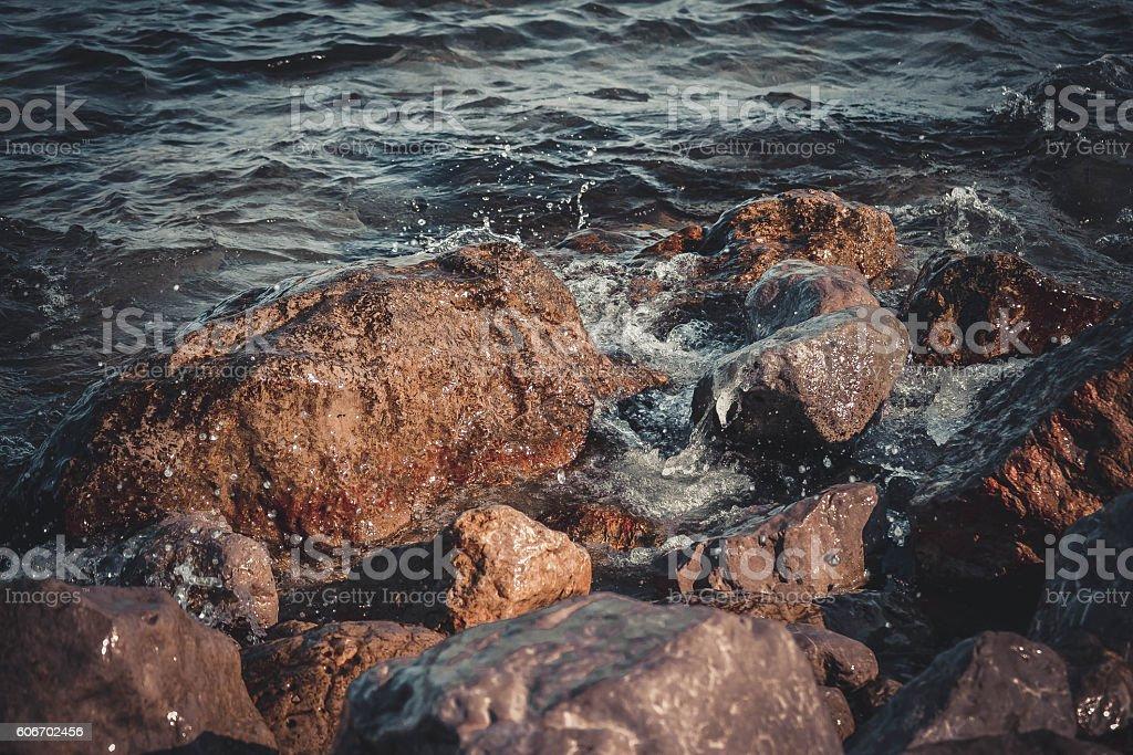 big wet rocks, splashing and shining sun stock photo