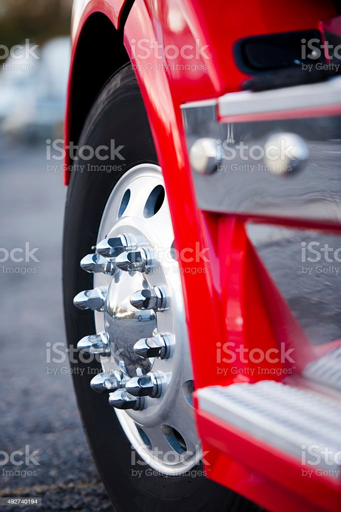 Big wheel aluminum reflection bolts rims red semi truck stock photo