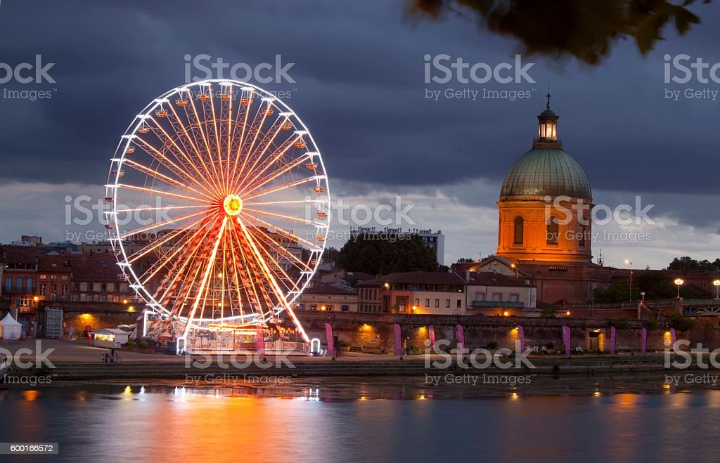 Big wheel at night with lights and the dome stock photo