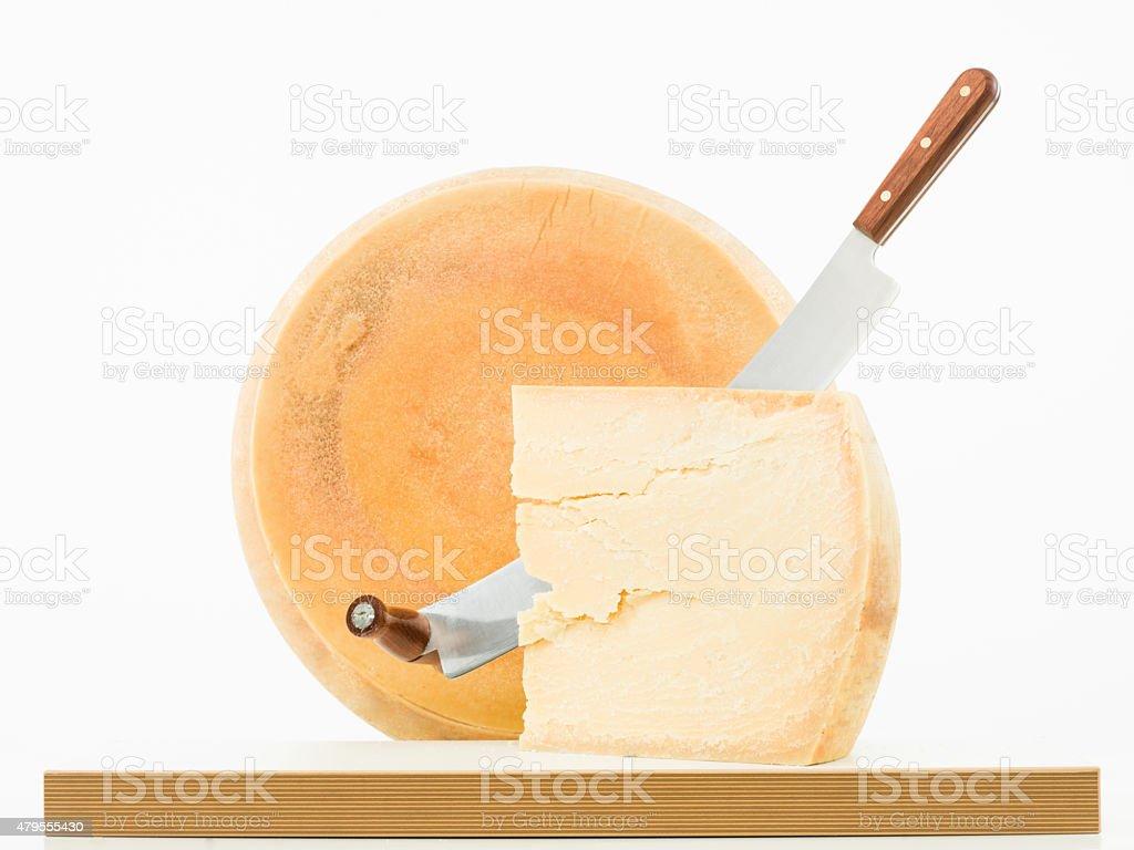 big wheel of grande padana parmesan cheese stock photo