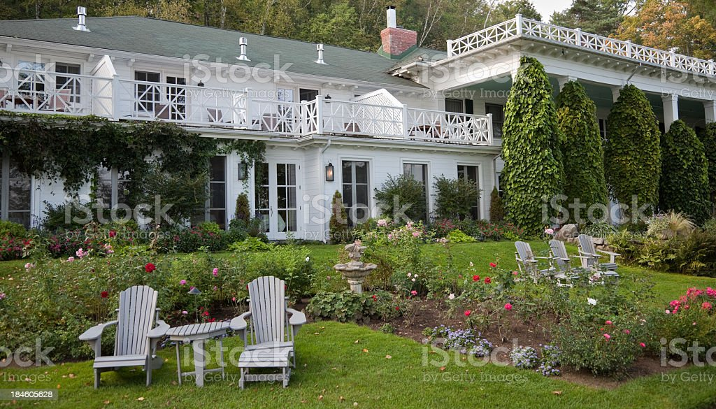 Big white country inn and garden royalty-free stock photo