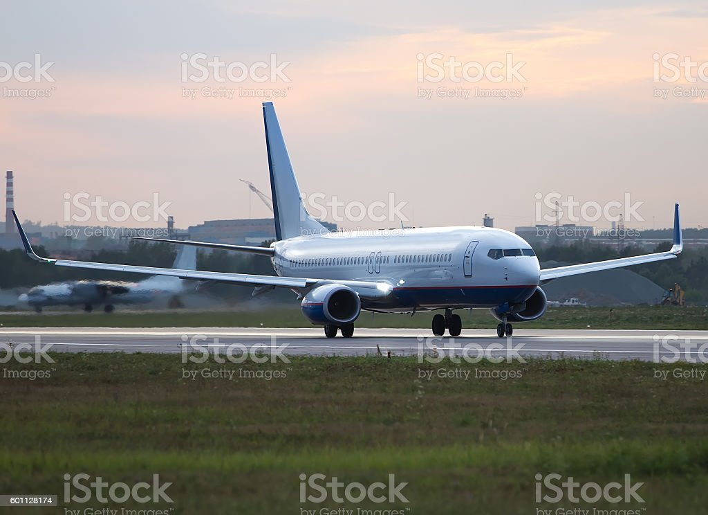 Big white passenger jet plane on runway at the airport stock photo