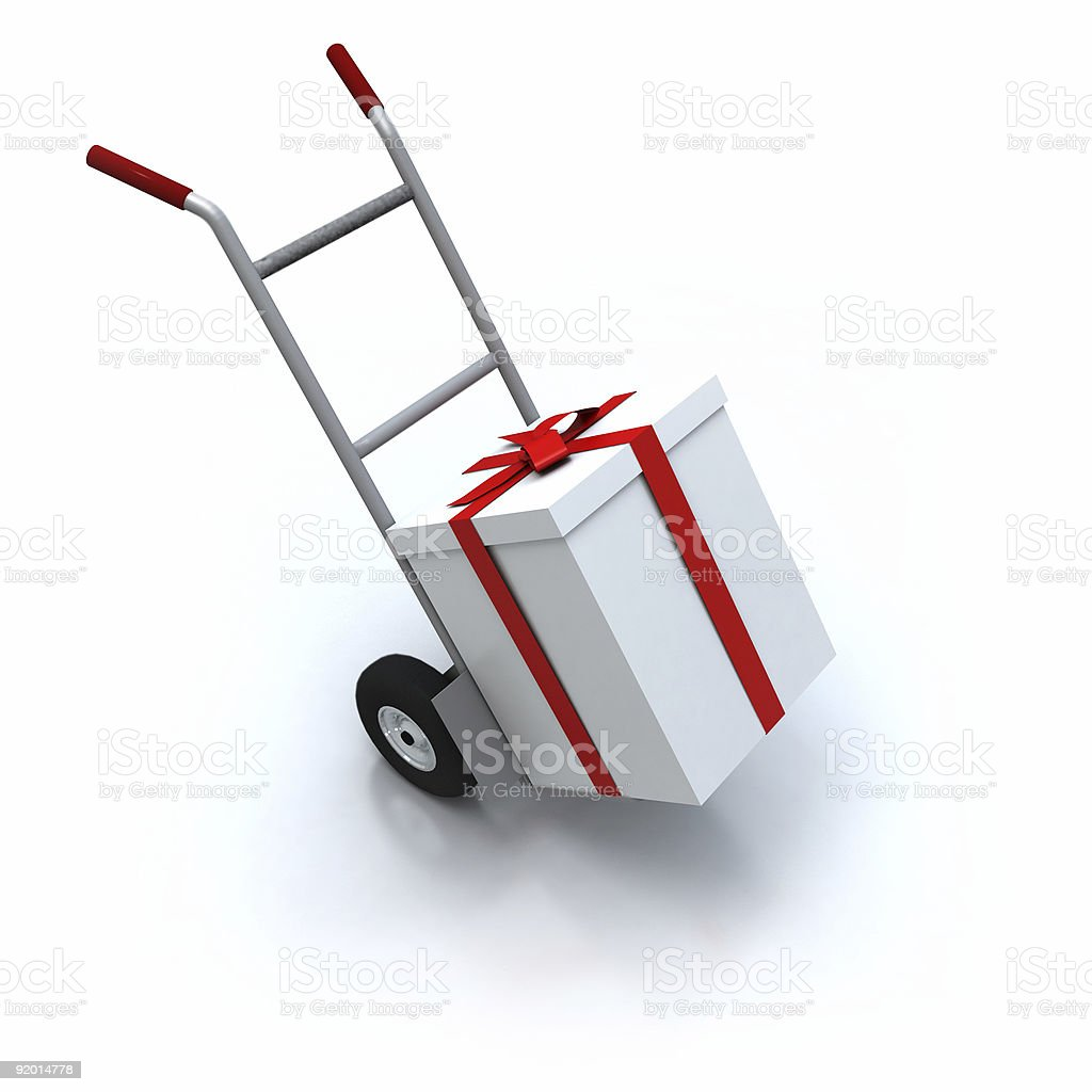 Big white present on a hand cart royalty-free stock photo