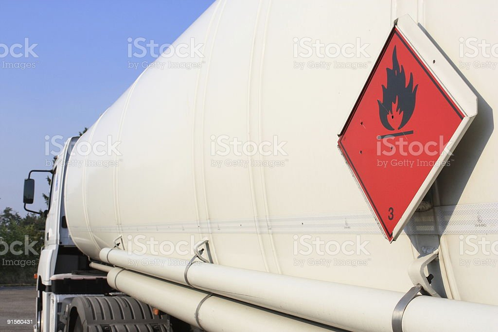 Big white tanker truck with red warning sign stock photo