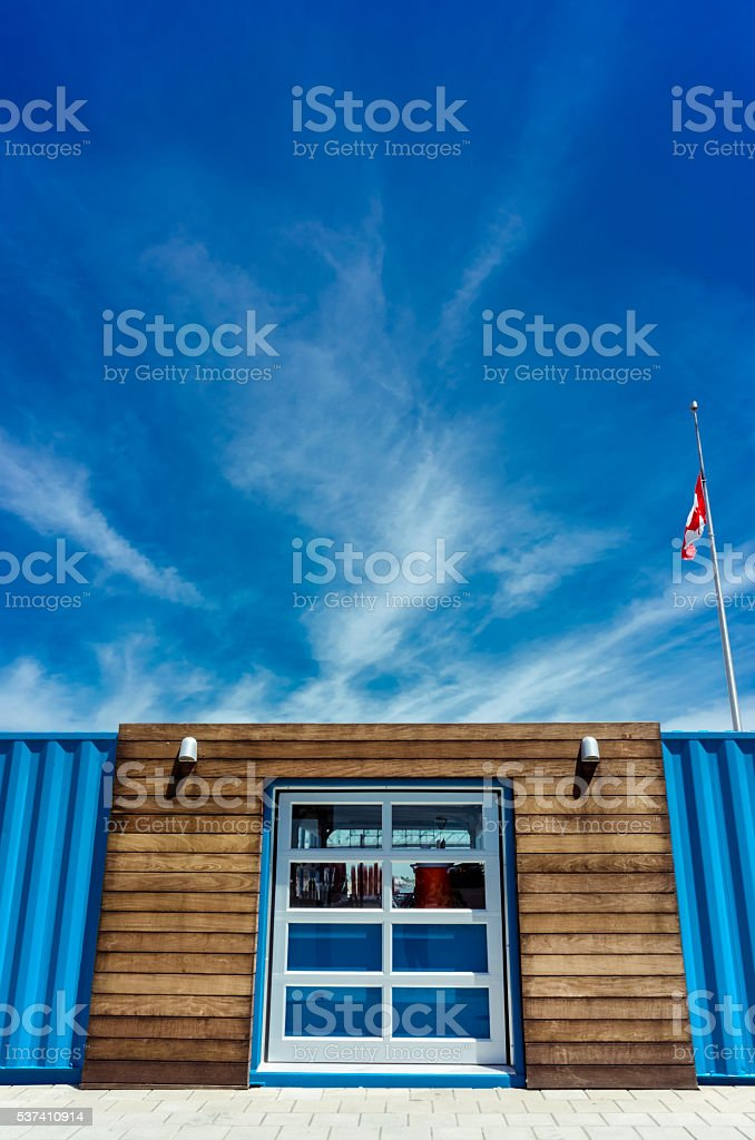 Big window between two ship containers stock photo