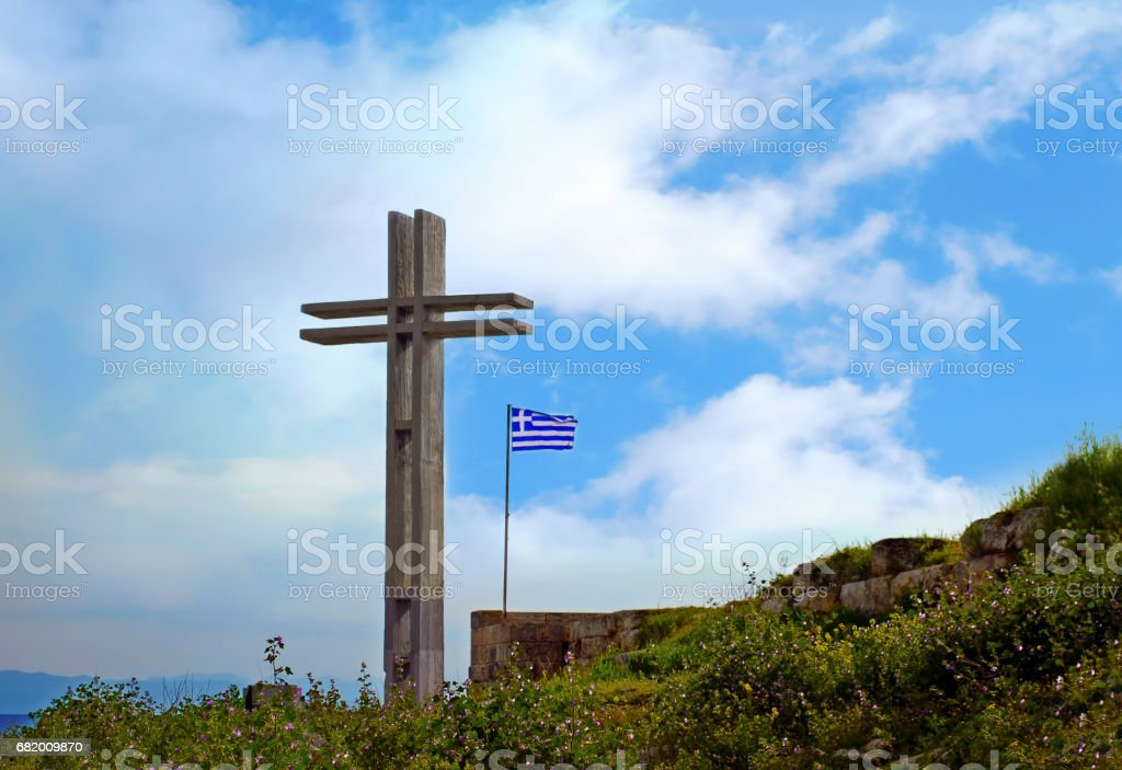 big wooden cross with the greek flag Piraeus Greece stock photo