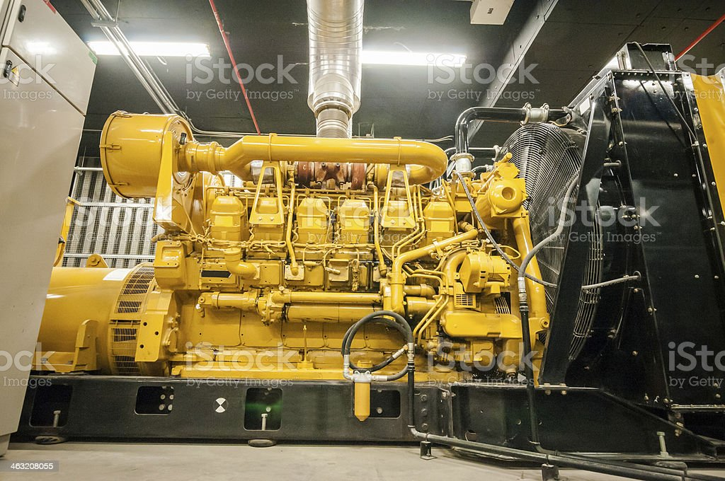 A big yellow metal electrical power generator stock photo