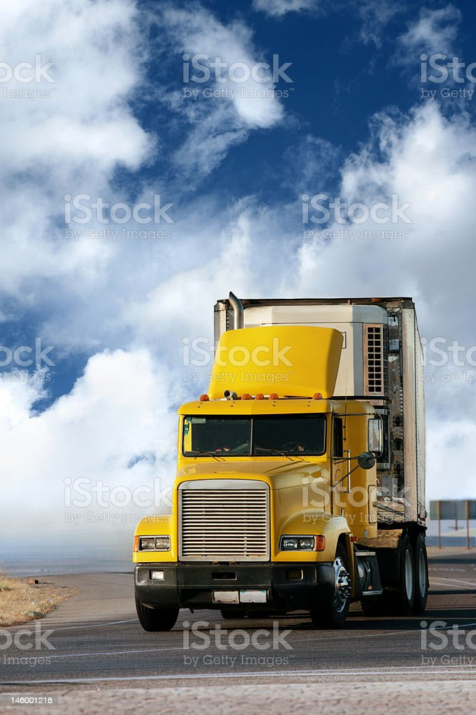Big yellow trailer on the road stock photo