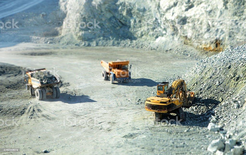 Big yellow trucks in quarry stock photo