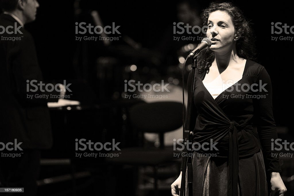 bigband: female jazz singer in performance behind the microphone stock photo