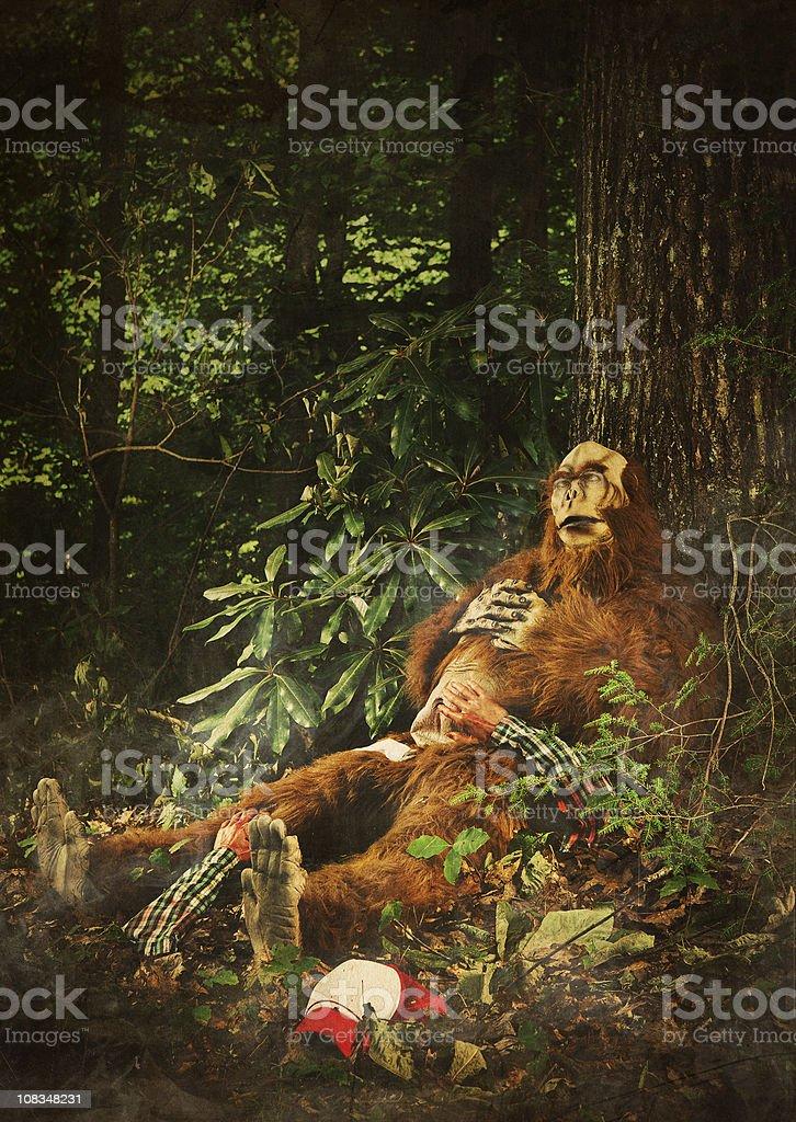 bigfoot sleeping after eating a human stock photo