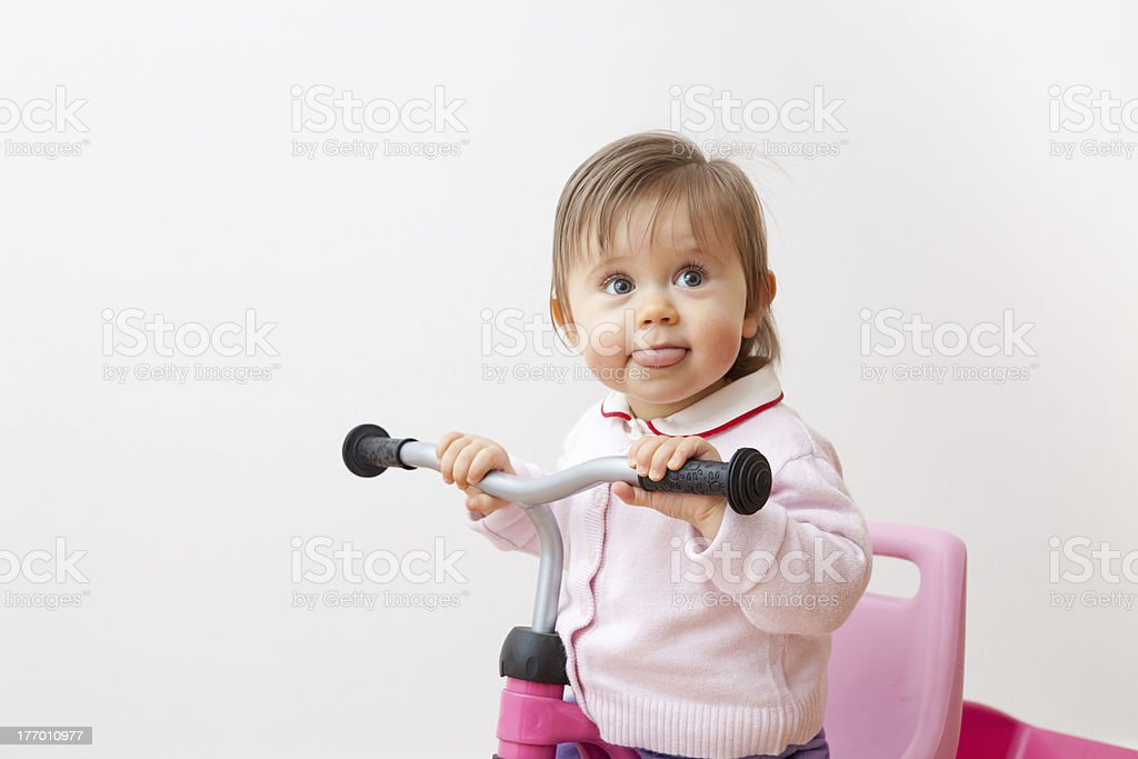 Bigmouth of a child on her tricycle stock photo
