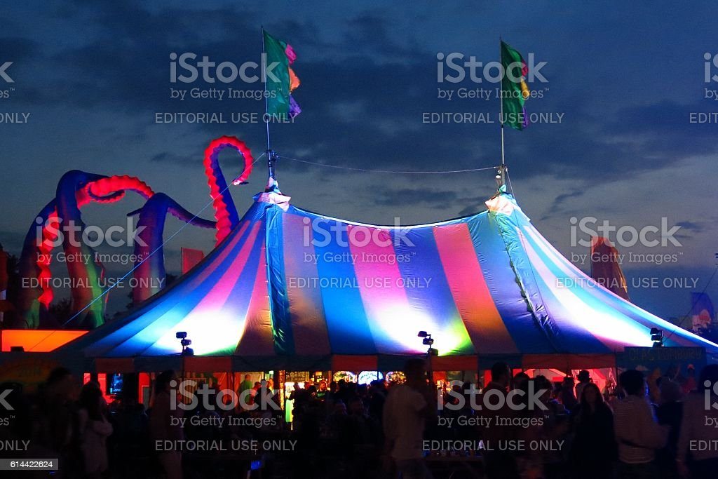 bigtop tent at Glastonbury Festival silhouetted by twilight sky stock photo