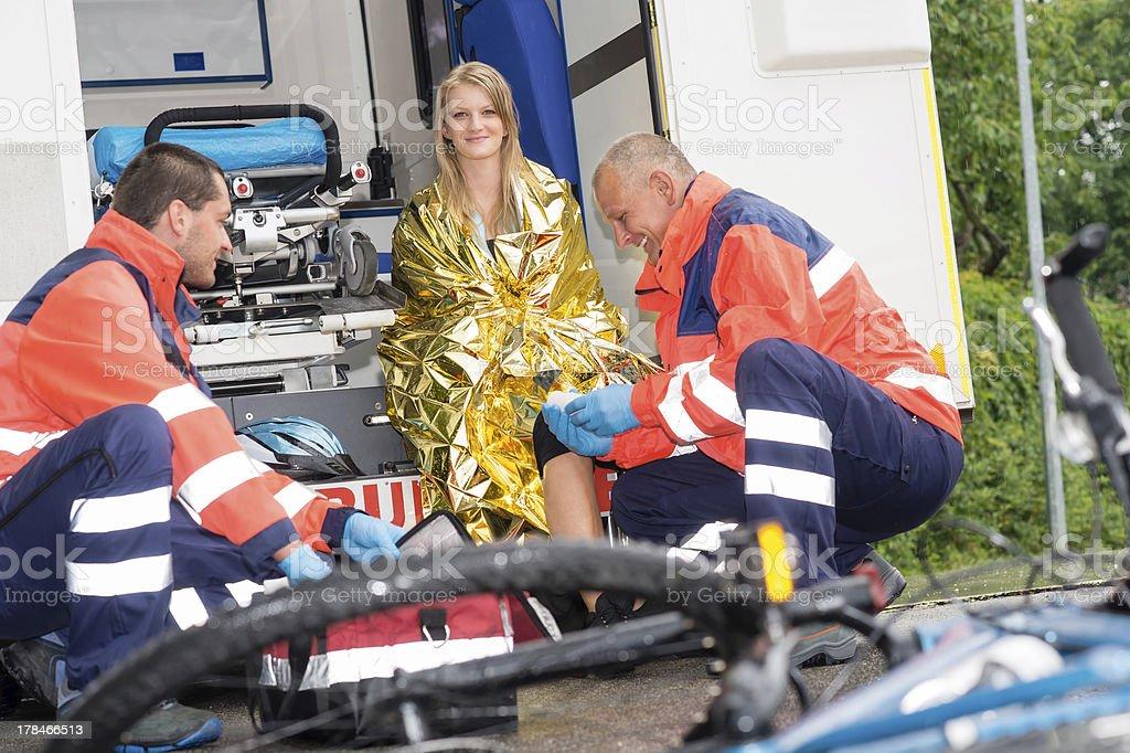 Bike accident woman emergency doctor bandage leg royalty-free stock photo