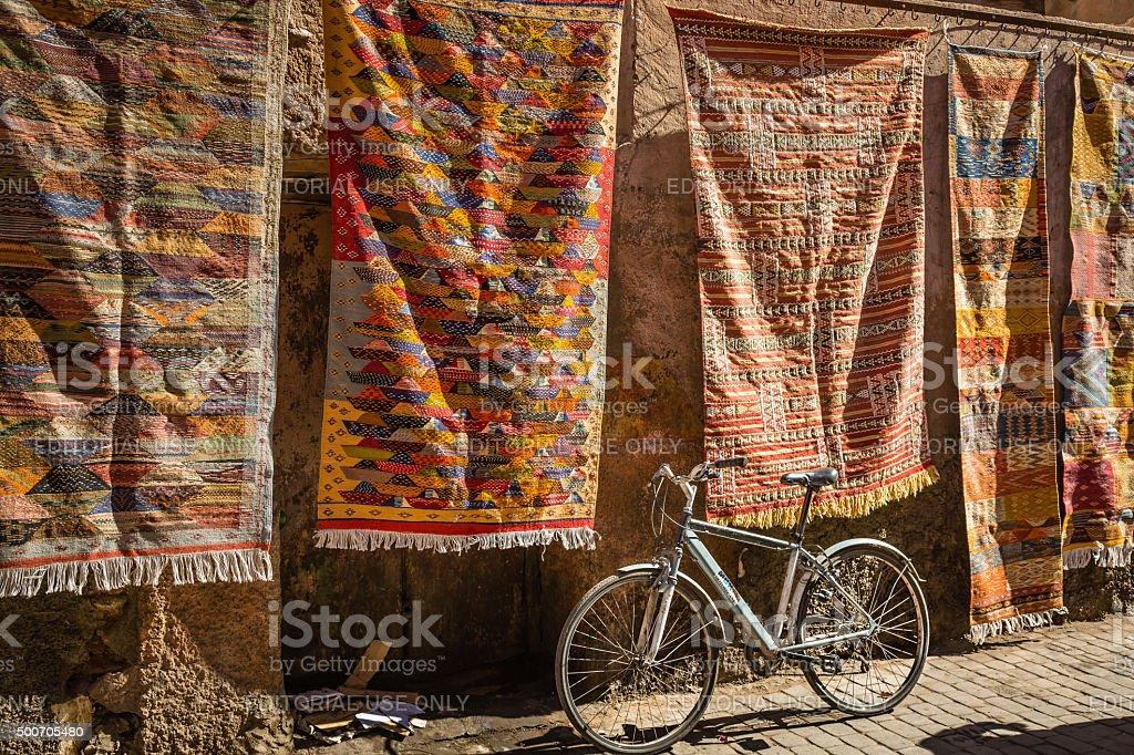 Bike and carpets stock photo