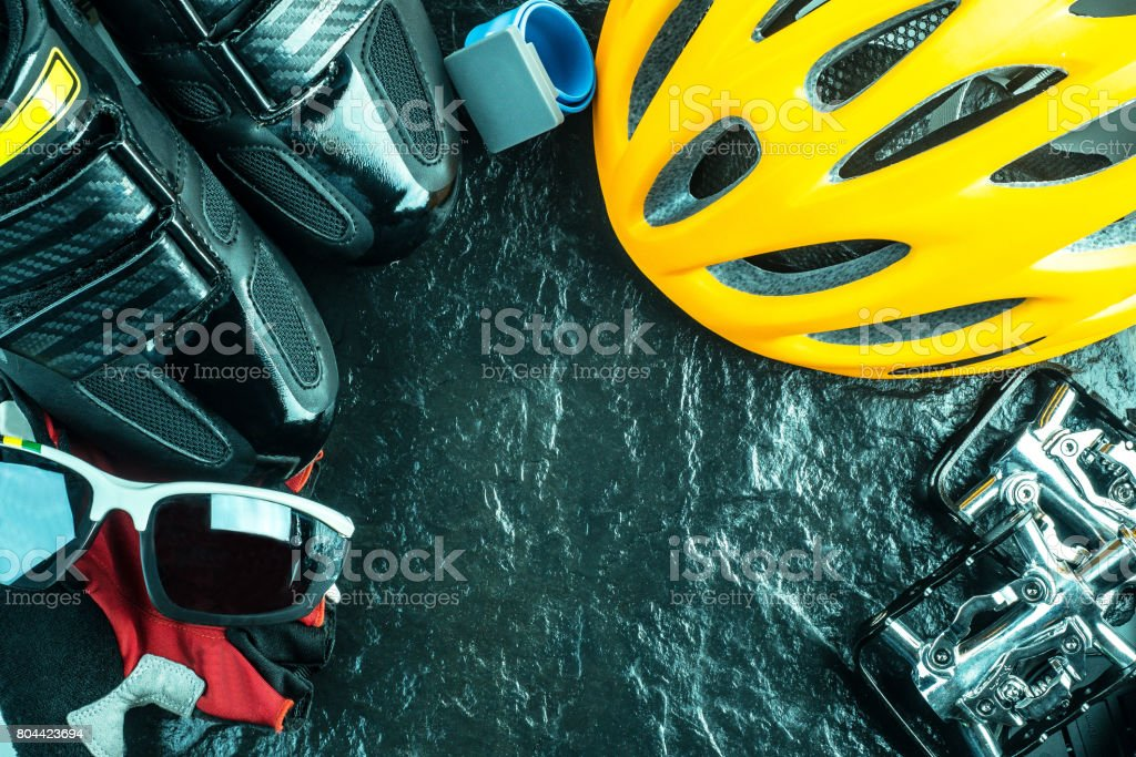 Bike and cycling sport accessories, border and frame, copy space, black stone background stock photo