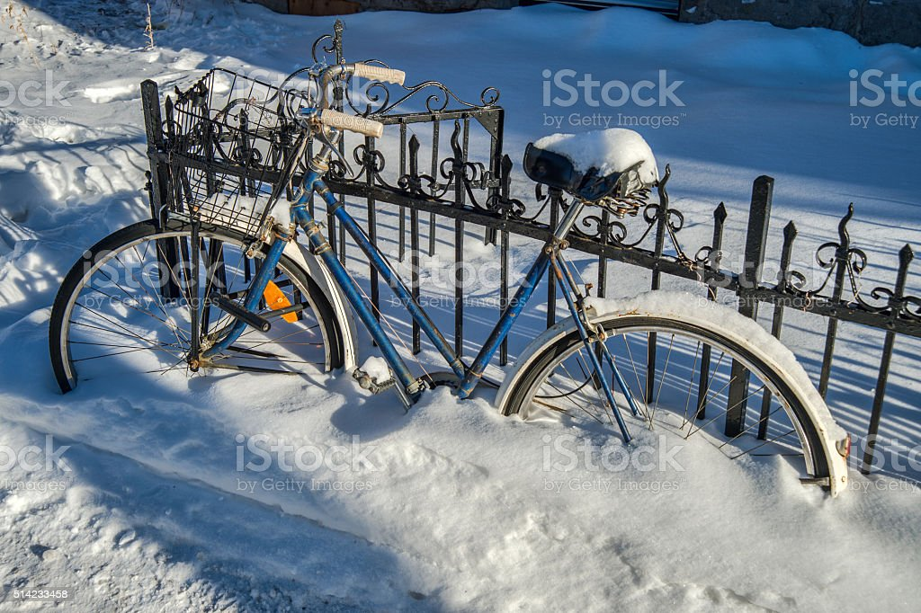 Bike covered with fresh snow in Montreal stock photo