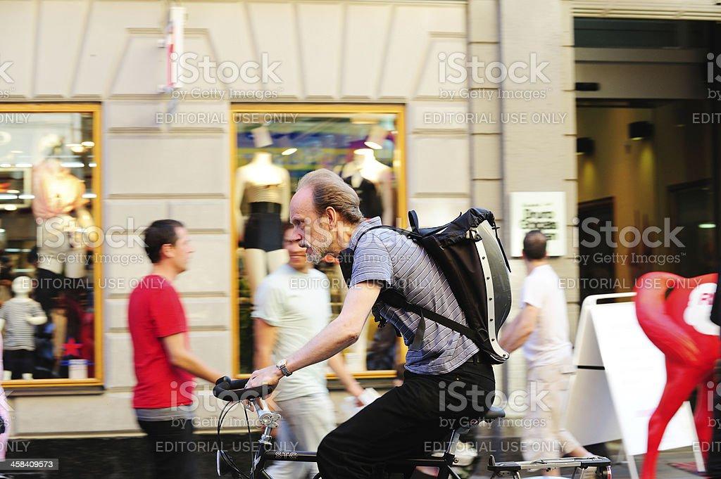 Bike in motion blurred traffic stock photo