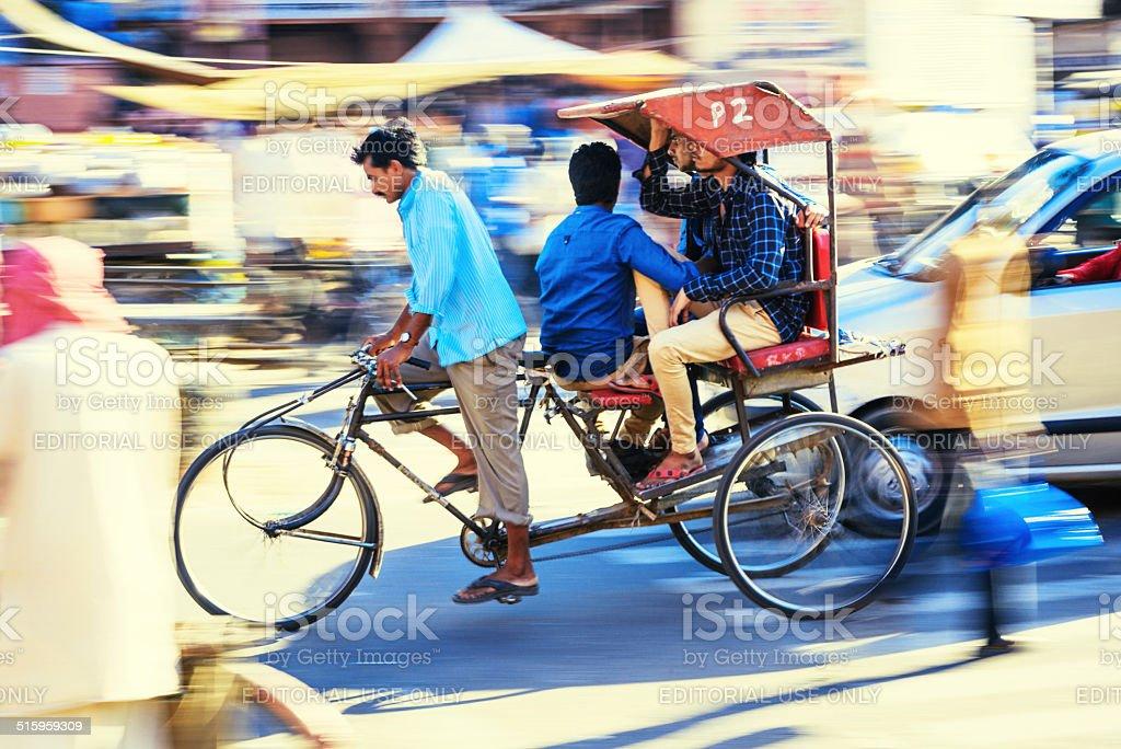 Bike in motion, street scene in India stock photo