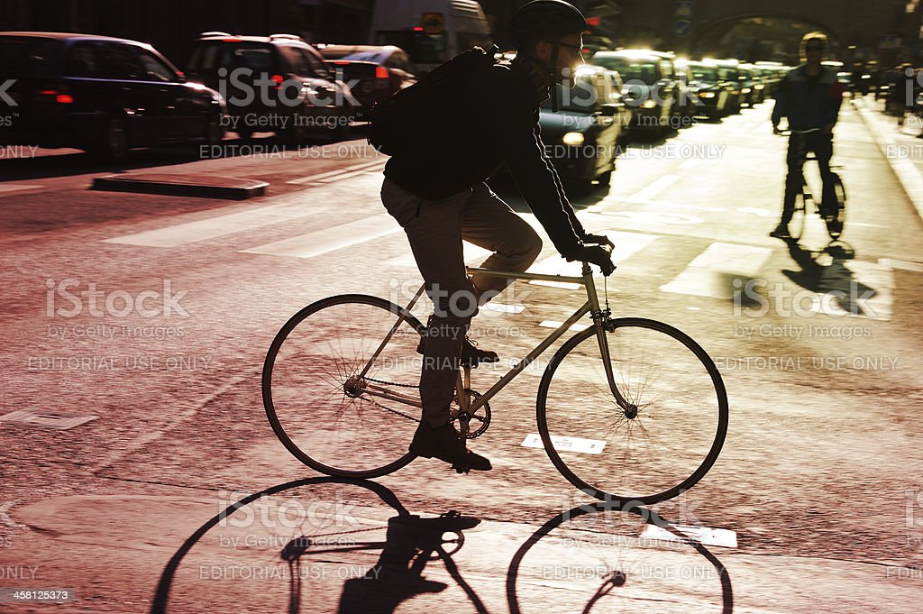 Bike in silhouette and zebra crossing royalty-free stock photo