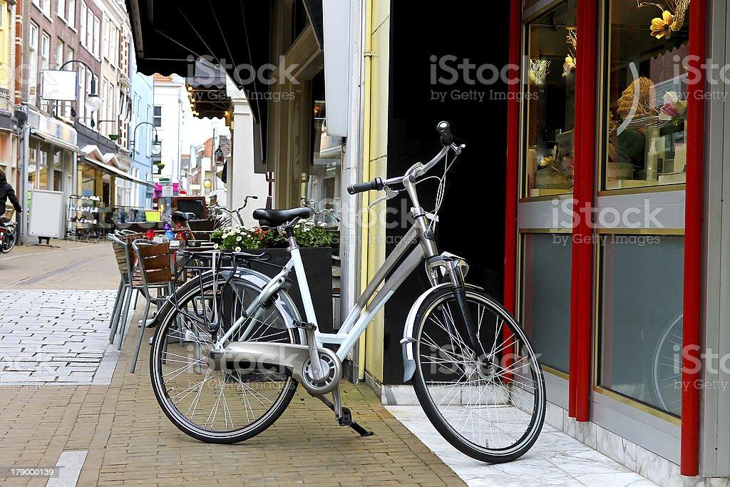 Bike is parked near  shop in Gorinchem. Netherlands royalty-free stock photo