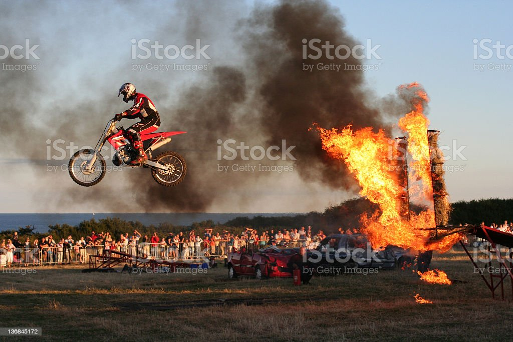 Bike Jumping Through Fire stock photo
