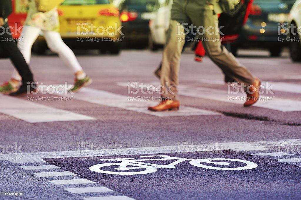 Bike lane, pedestrians and a zebra crossing royalty-free stock photo