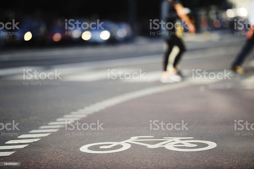 Bike lane symbol and zebra crossing in traffic stock photo