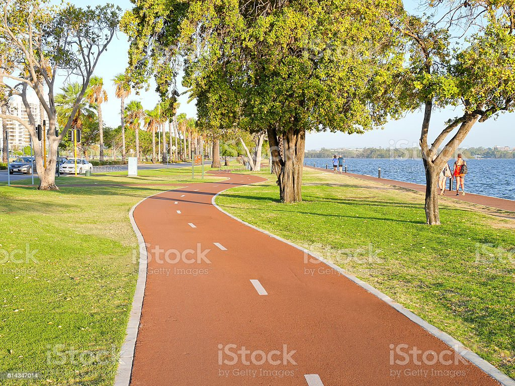 Bike lanes in the park along the river in evening stock photo