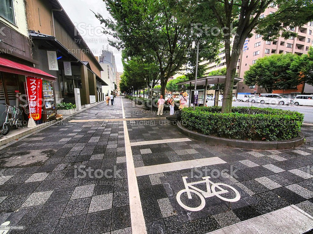 Bike line on pavement in Kyoto, Japan stock photo