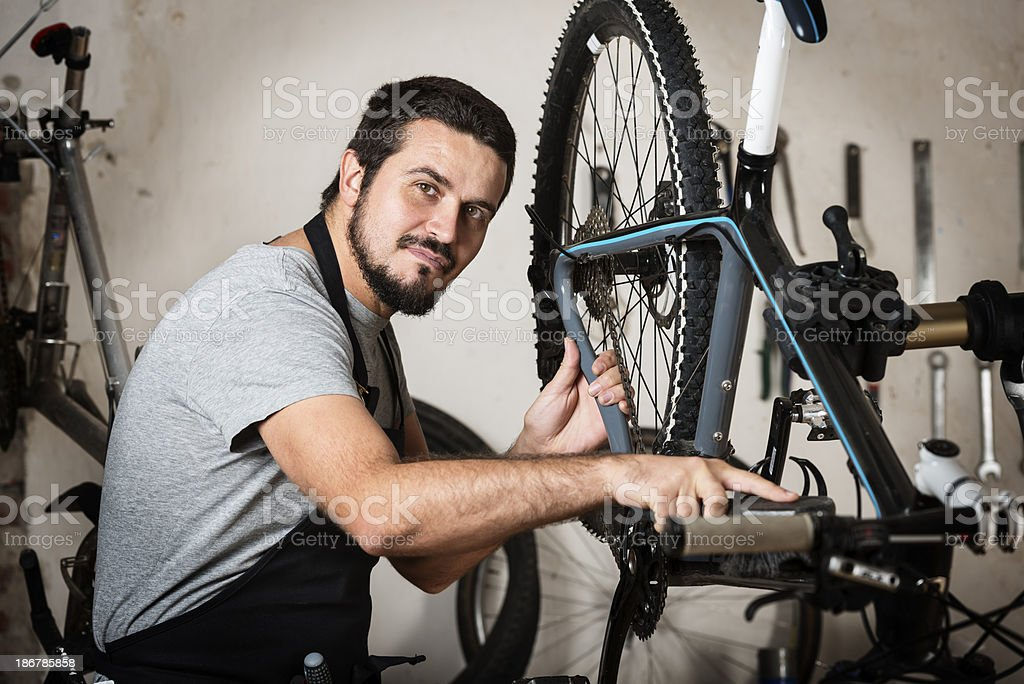 Bike Mechanic At Work In His Workshop royalty-free stock photo