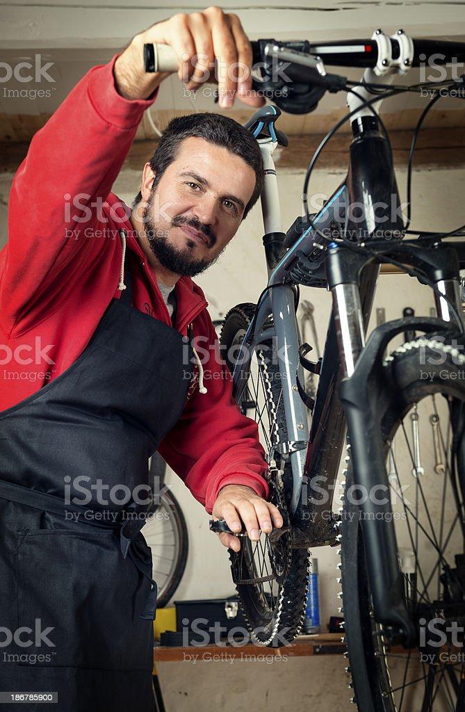 Bike Mechanic At Work royalty-free stock photo