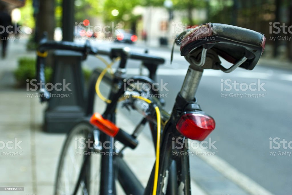 Bike on urban street in downtown section of city stock photo