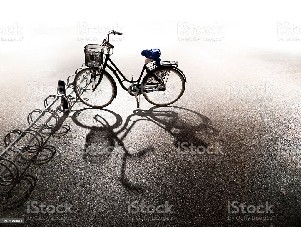 Bike parked in bicycle rack stock photo