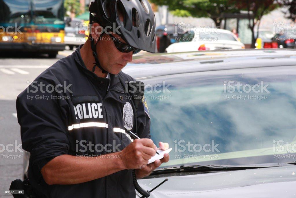 Bike Patrol Police Officer Working stock photo