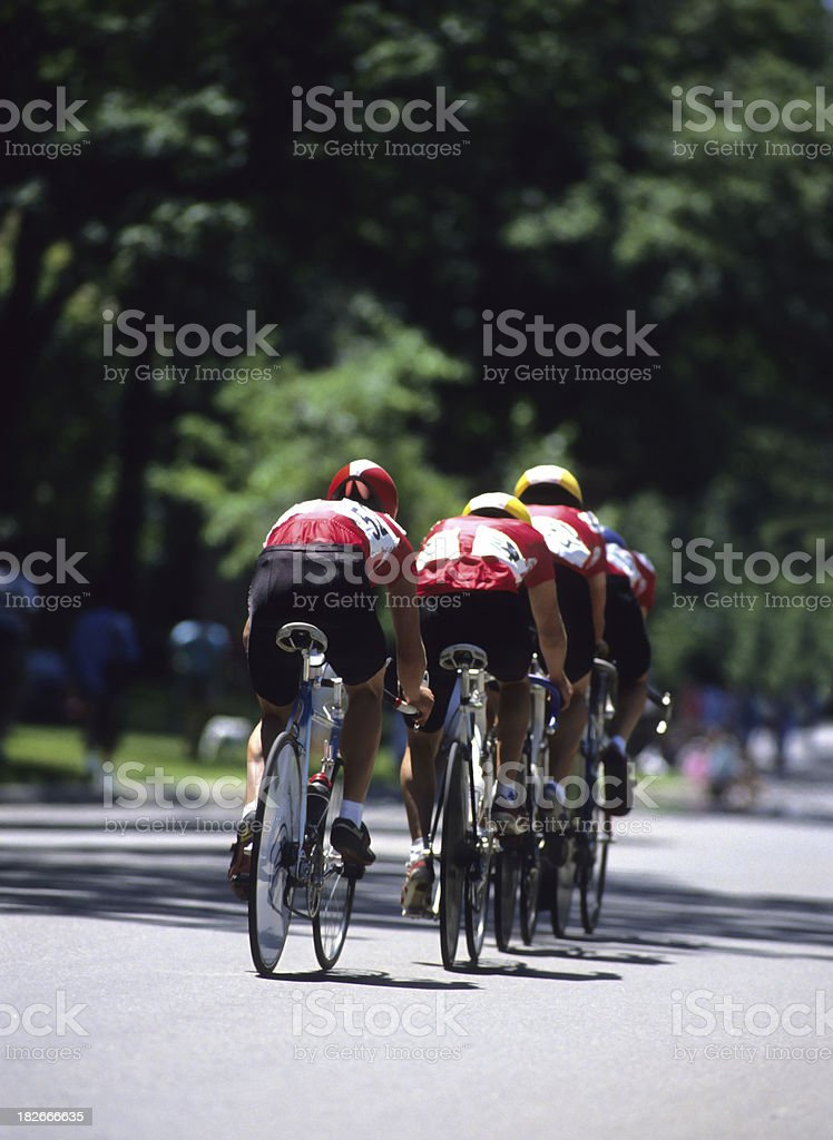 bike racing team in formation stock photo