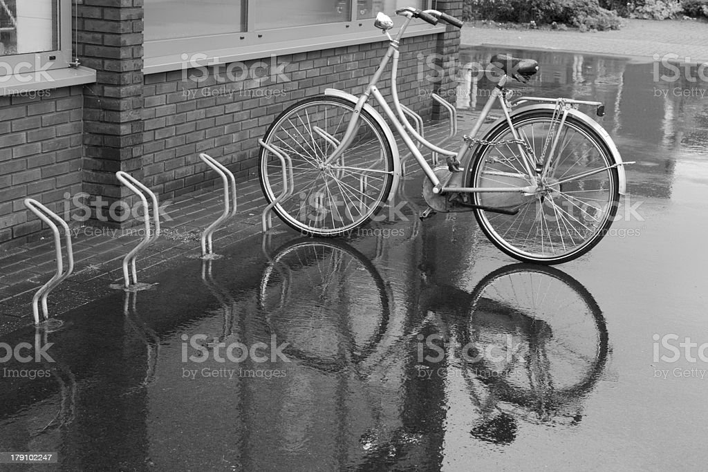 Bike reflected on a water puddle royalty-free stock photo