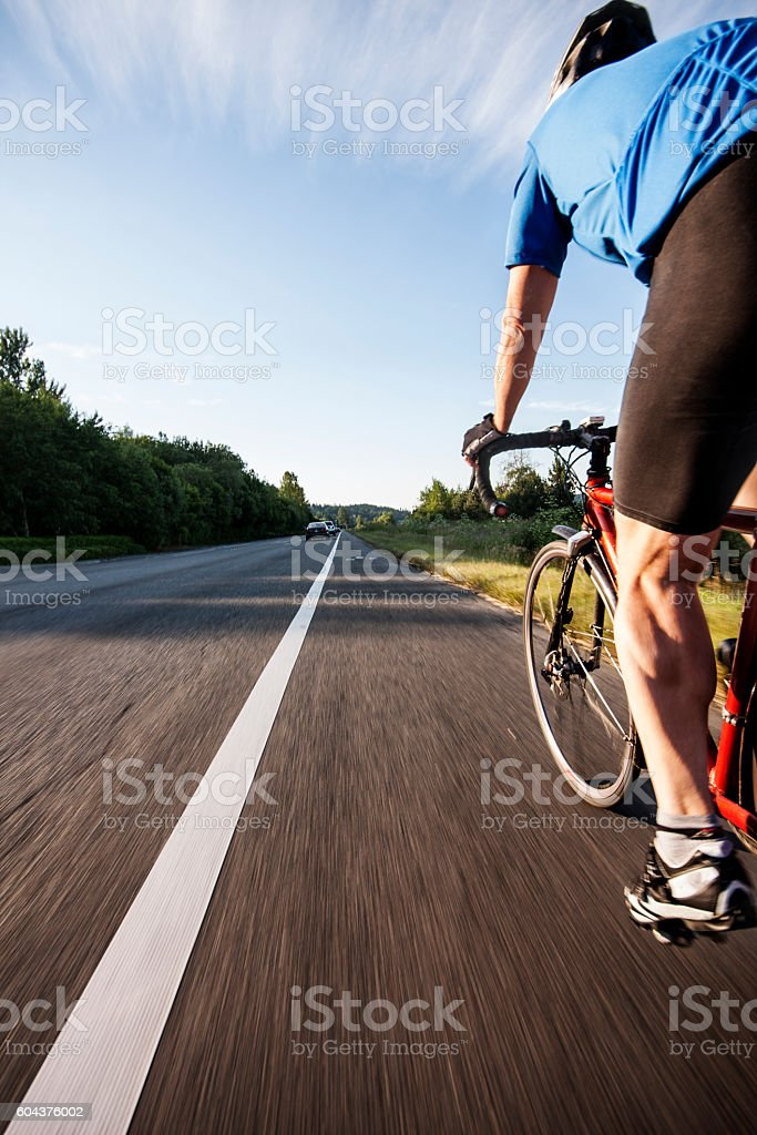 Bike Ride on a Highway Shoulder stock photo