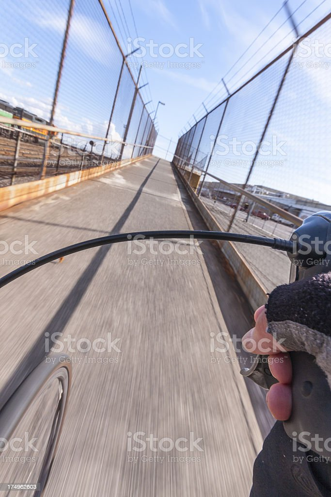 Bike Ride through indusrial area on a fenced in trail royalty-free stock photo